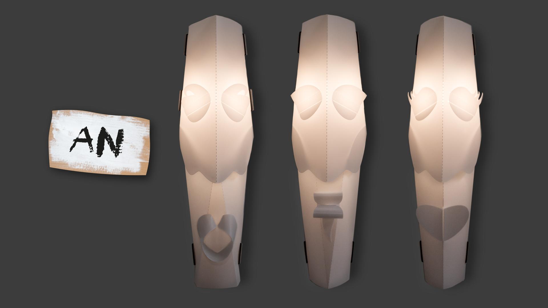 """Ethnolampen Masken der bei Werkhaus vertriebenen Lampenserie mit einem Pappschild, auf dem in Großbuchstaben das Wort """"An"""" steht"""